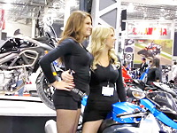 See the tight shorts girls modeling the new bike on the fest. Both chicks take erotic poses for the camera devices of excited men